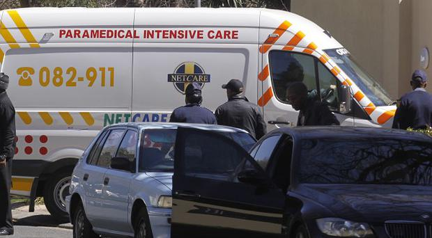 An ambulance transporting former South African president Nelson Mandela arrives at his home in Johannesburg (AP)