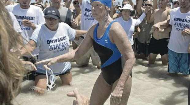 Endurance swimmer Diana Nyad is greeted by a large crowd after her record-breaking swim