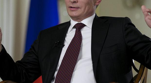 Russian President Vladimir Putin expressed hope that he and President Barack Obama would have serious discussions in St Petersburg (AP)