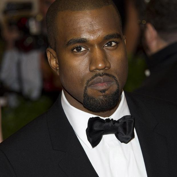 Kanye West's turn at a Kazakhstan wedding has been criticised by a human rights group (AP)