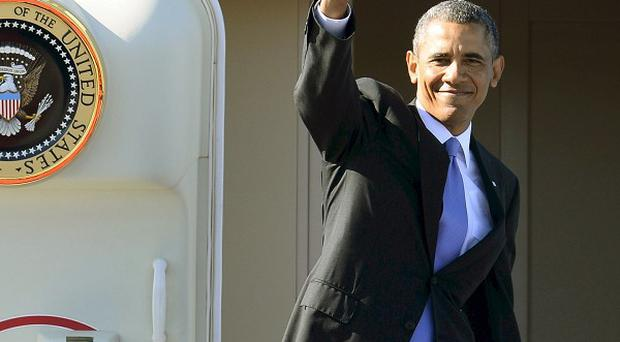 US president Barack Obama waves from Air Force One during his departure at Stockholm-Arlanda International Airport (AP)