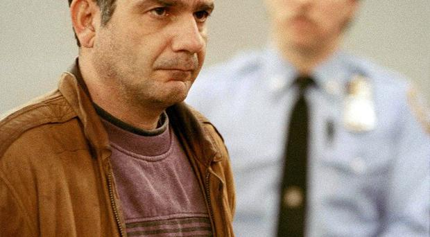 John Esposito faces the court during his arraignment in 1993 on charges he kept a 10-year-old girl prisoner (AP)