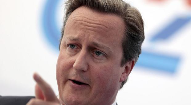 Prime Minister David Cameron said an 'extremely powerful' case was made by those in favour of military action in Syria (AP)