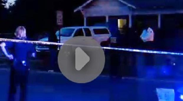 Police surround a home in Pine Bluff, Arkansas, during a standoff that left an elderly man dead (AP/Courtesy of KATV)