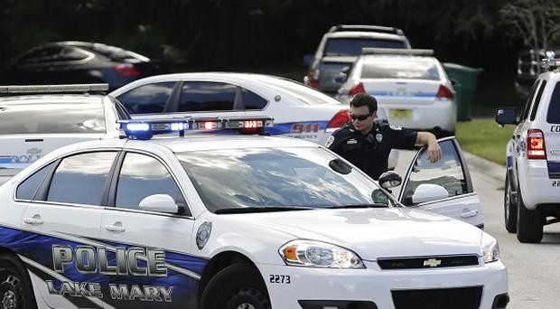 Police cars at the scene of a domestic incident in Florida where George Zimmerman and his wife had lived during his murder trial (AP/John Raoux)