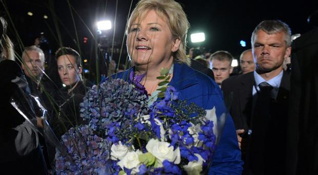 Norway's main opposition leader Erna Solberg of the Conservative Party outside the Parliament building in Oslo (AP/Aleksander Andersen, NTB Scanpix)