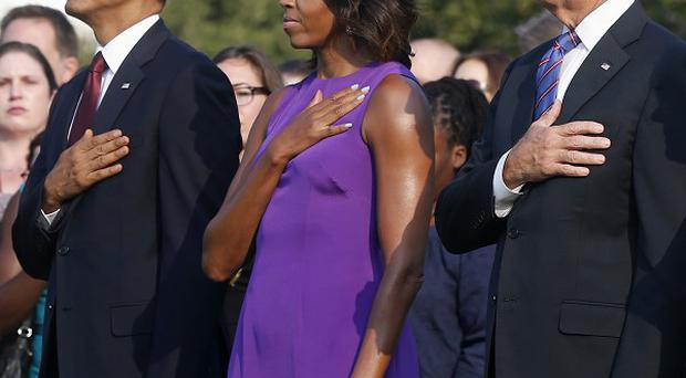 President Barack Obama, Michelle Obama, vice president Joe Biden, and wife Jill marking the anniversary of 9/11 (AP)