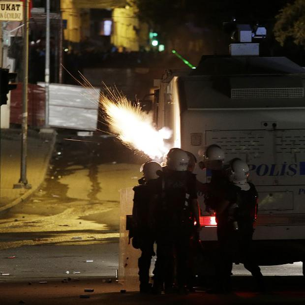Turkish police fire teargas during clashes in Hatay, Turkey (AP/Gregorio Borgia)