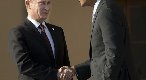 Barack Obama shakes hands with Vladimir Putin during the G-20 summit at the Konstantin Palace in St Petersburg, Russia (AP/Pablo Martinez Monsivais)