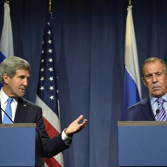 US Secretary of State John Kerry speaks to Russian Foreign Minister Sergey Lavrov (AP/Keystone, Martial Trezzini)