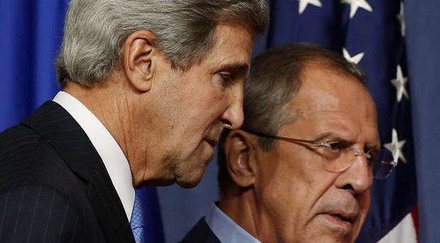 US Secretary of State John Kerry and Russian Foreign Minister Sergey Lavrov ahead of a meeting in Geneva, Switzerland (AP/Larry Downing)