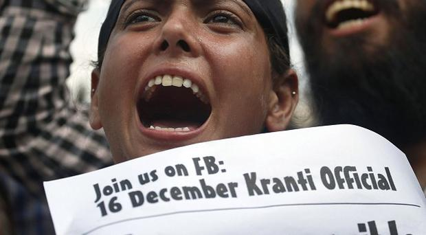 Protestors demand the four men convicted in the fatal gang rape of a young woman be sentenced to death (AP/Saurabh Das)