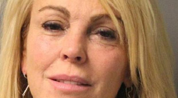Dina Lohan after she was arrested on aggravated drunken driving charges (AP/New York State Police)