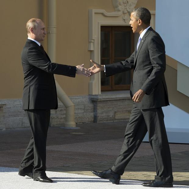 US president Barack Obama met Russian president Vladimir Putin during the G-20 summit in St Petersburg (AP)