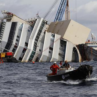 Teams will attempt to upright the Costa Concordia off Tuscany (AP)