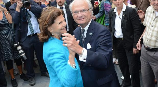 Queen Silvia and King Carl XVI Gustav of Sweden dance in the palace courtyard in Stockholm (AP)