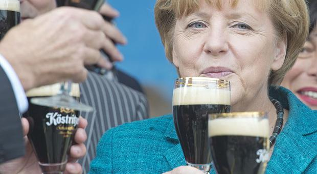 German Chancellor Angela Merkel attends an election campaign event in Bad Koestritz, central Germany (AP)