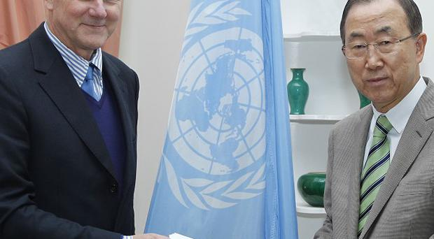 Prof Ake Sellstrom, head of the chemical weapons team working in Syria, gives the report to secretary-general Ban Ki-moon (AP/UN/Paulo Filgueiras)