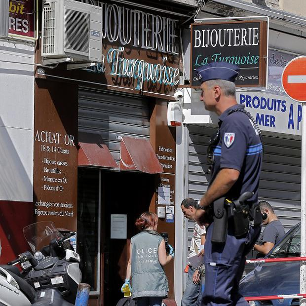 Police outside the shop where a jeweller shot dead a robber (AP)