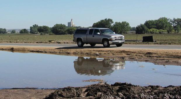 Flooding could ultimately provide relief to Colorado's drought-hit farming communities (AP)