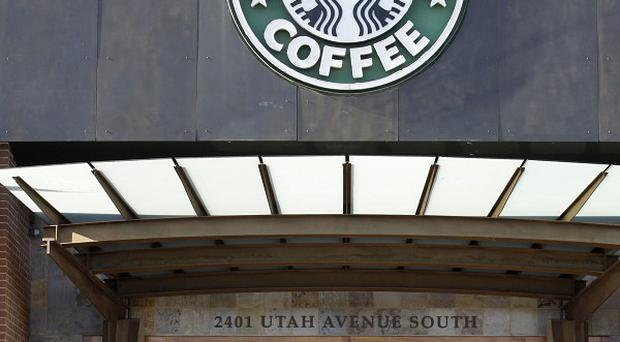 Starbucks wants its customers in the US to leave their guns at home (AP)