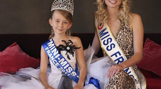 Oceane Scharre, 10, Mini Miss France 2011 and Miss France 2011 Mathilde Florin - parliament wants to ban child beauty contests (AP)