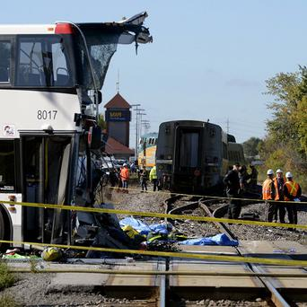 The mangled bus after it hit the train (AP)
