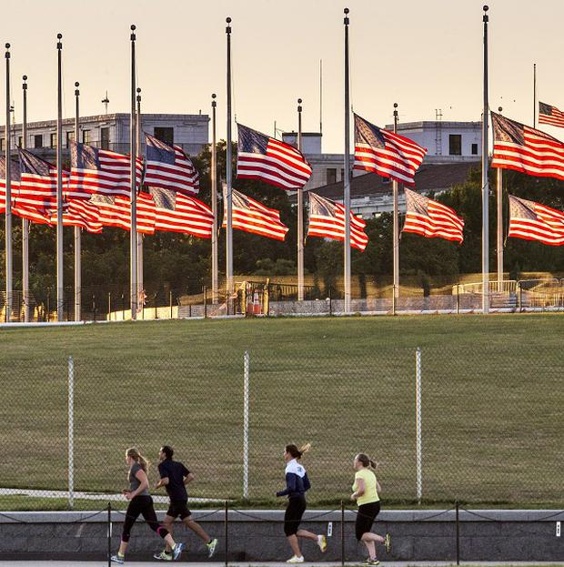 American flags surrounding the Washington Monument fly at half-mast following the deadly shooting at the Washington Navy Yard (AP)