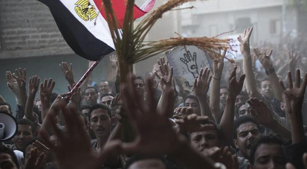 Supporters of Egypt's ousted President Mohammed Morsi chant slogans against Egyptian Army during a protest in Dalga, south of Cairo (AP)
