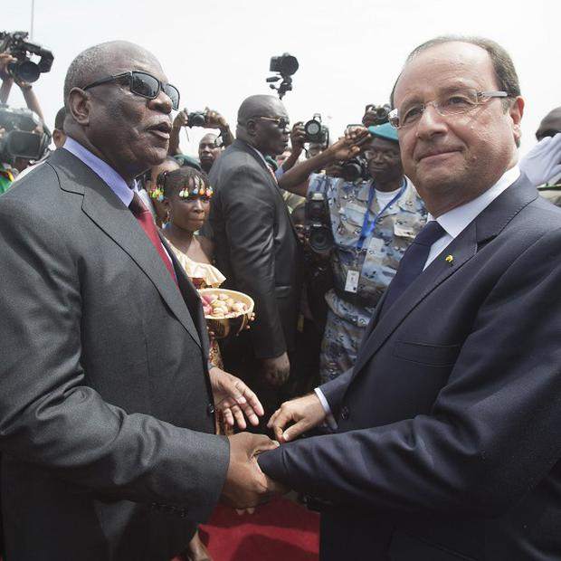 Mali's new president Ibrahim Boubacar Keita, left, welcomes France's president Francois Hollande (AP)