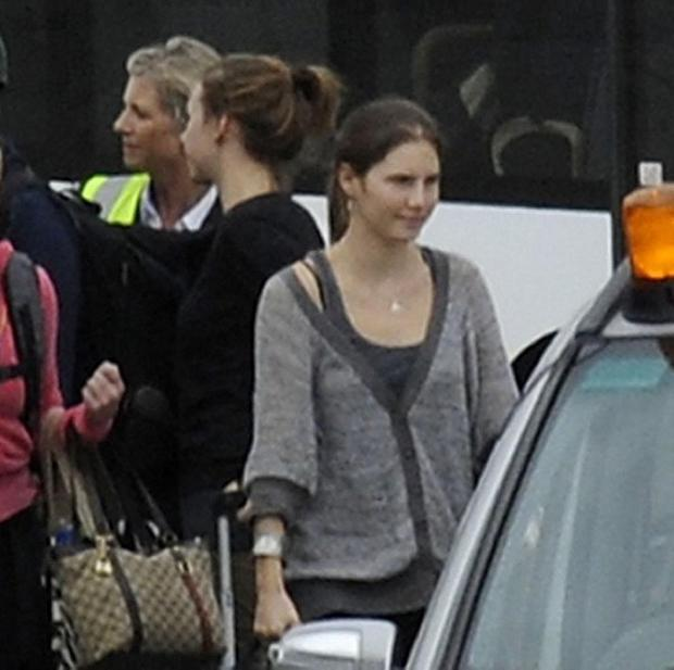 Amanda Knox (right) at Heathrow Airport after she was acquitted of the murder of British student Meredith Kercher.