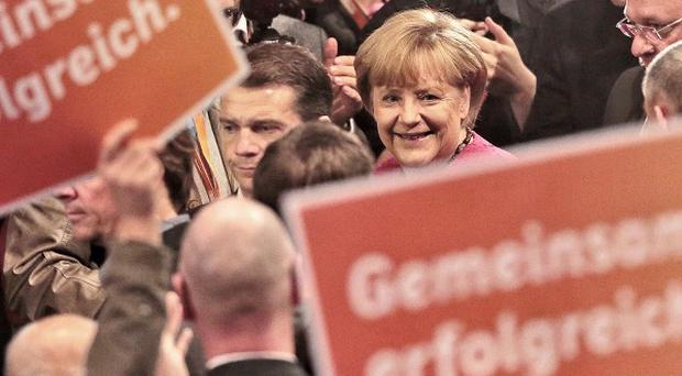 German Chancellor Angela Merkel arrives at the final election campaign event in Berlin (AP)