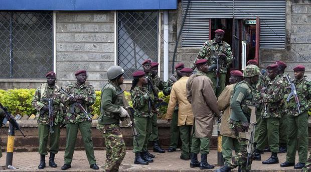 Kenya troops take their positions outside a shopping mall in Nairobi (AP)