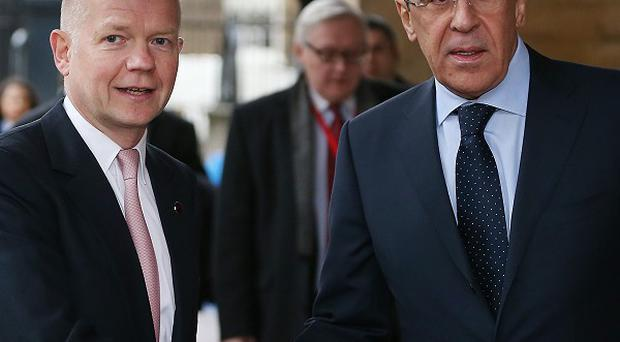 Russia's foreign minister Sergey Lavrov, right, pictured here with William Hague, says his countrywill not send a full military contingent to Syria
