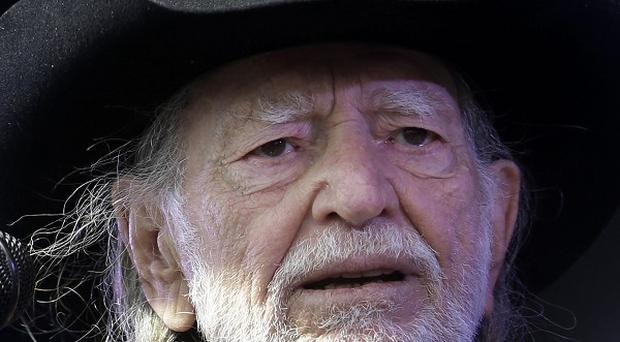 A stuffed armadillo was stolen from the stage after a Willie Nelson concert (AP/Gerald Herbert)