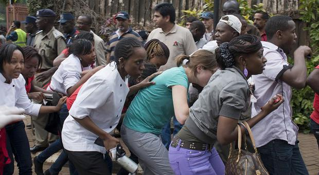 Civilians who had been hiding inside during the gun battle flee from the Westgate Mall.