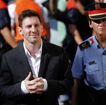 Barcelona star Lionel Messi arrives at a court to answer questions in a tax fraud case in Gava, near Barcelona, Spain. (AP/Emilio Morenatti)