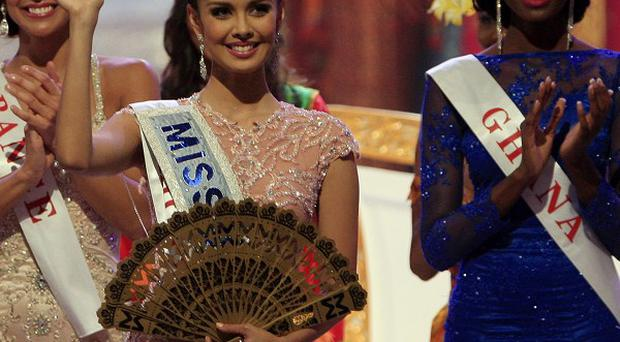 Megan Young waves after winning the Miss World contest (AP)