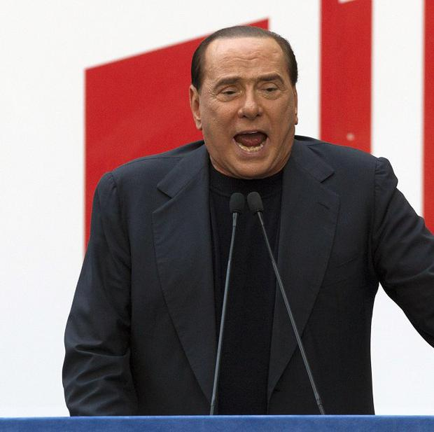 Silvio Berlusconi urged ministers in his party to step down if the government does not revoke an increase to Italy's value-added tax (AP/Andrew Medichini)