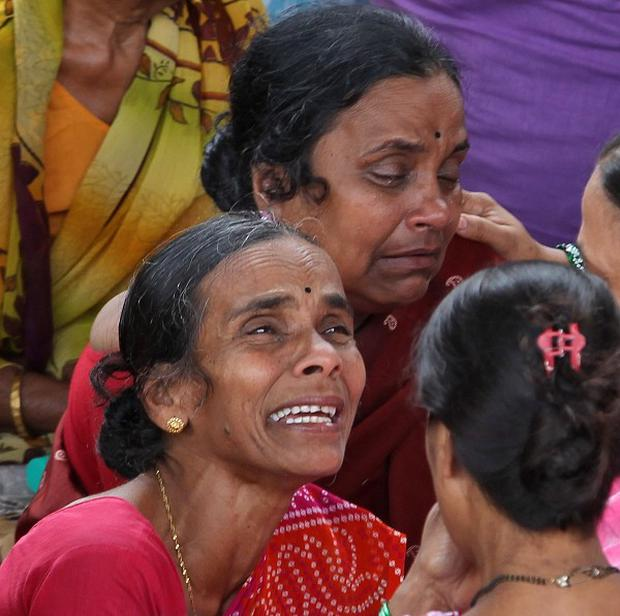 Indian women cry for missing relatives at the site of a building that collapsed, in Mumbai, India (AP/Rajanish Kakade)