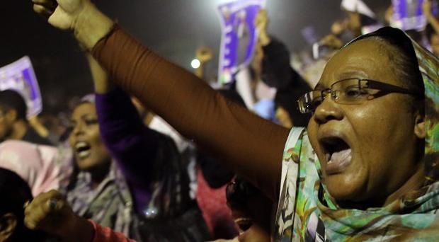 Sudanese anti-government protesters chant slogans during a demonstration in Khartoum.