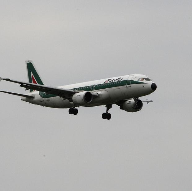 An Alitalia Airbus 320 landed on the tarmac leaning on a wing and its tail after the right-side landing gear did not work
