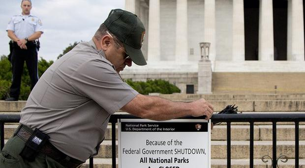 A US National Park Service employee closes access to the Lincoln Memorial in Washington, DC amid a partial government shutdown