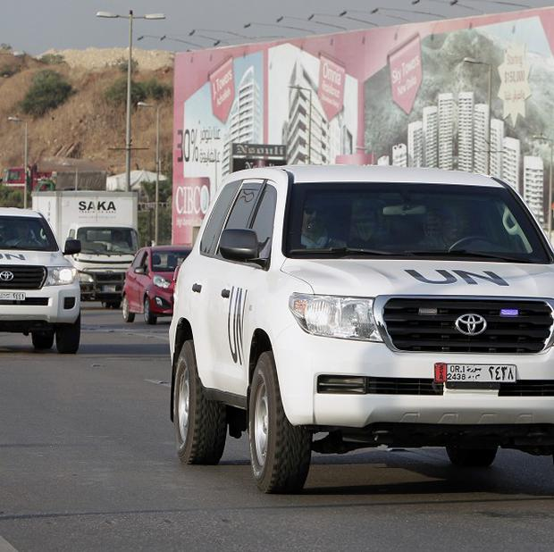 Weapons inspectors on their way in to Syria from Beirut (AP)