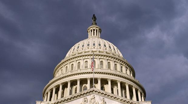 A partial US government shutdown has forced some 800,000 federal workers off their job (AP)