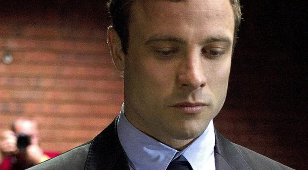 Forensic experts have visited the villa where double-amputee Olympian Oscar Pistorius killed his girlfriend (AP)