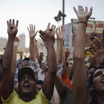 Supporters of Egypt's ousted President Mohammed Morsi chant slogans against Egyptian Defence Minister Gen Abdel-Fattah el-Sissi in Cairo.