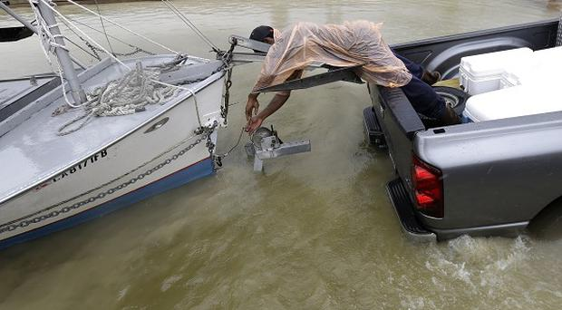 CJ Johnson pulls a shrimp boat out of the water in preparation for the arrival of Tropical Storm Karen (AP)