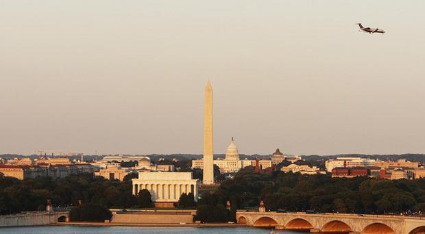 A man has been flown to hospital after setting himself on fire on the National Mall in Washington DC.