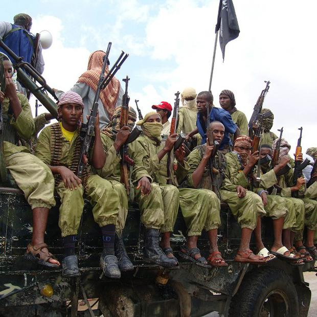 Al-Shabab fighters in Mogadishu - the terrorists have been linked to a target of the US raid on Somalia (AP)